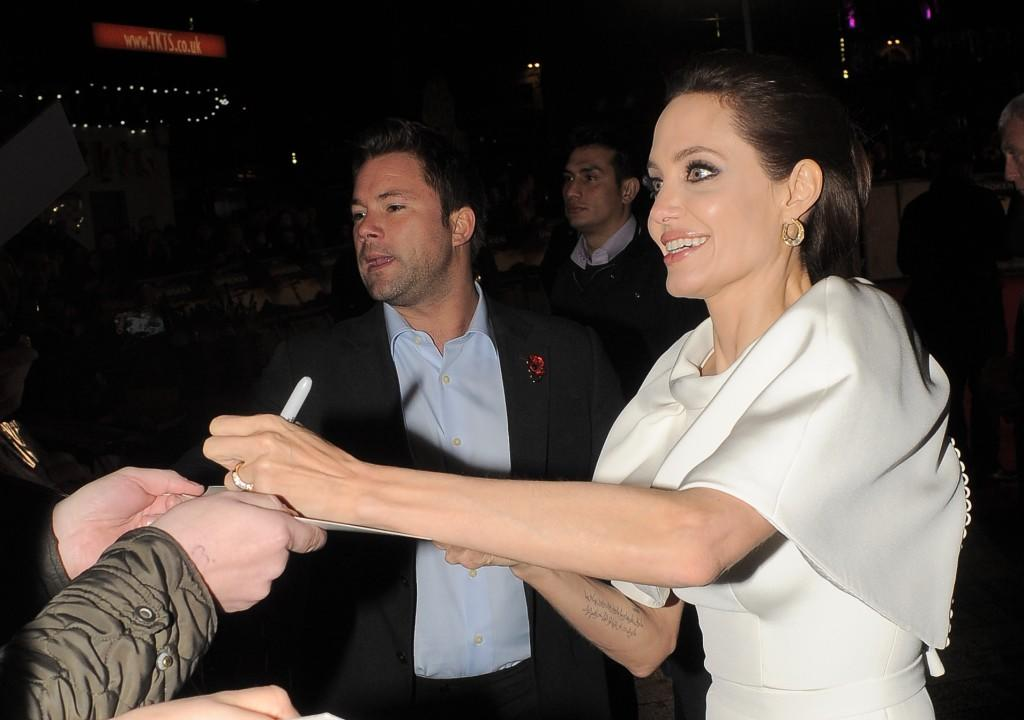 Jolie has been pictured multiple times signing autographs with her left hand.