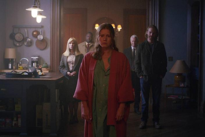 """Amy Adams (center) is Anna Fox in the Netflix original movie """"Woman in the Window."""" Also pictured, left to right: Jennifer Jason Leigh as Jane Russell, Brian Tyree Henry as Detective Little, Gary Oldman as Alistair Russell and Wyatt Russell as David."""