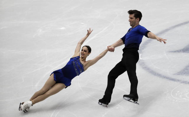 United States' skaters Deanna Stellato and Nathan Bartholomay perform during a pairs short program at the Figure Skating World Championships in Assago, near Milan, Wednesday, March 21, 2018. (AP Photo/Luca Bruno)