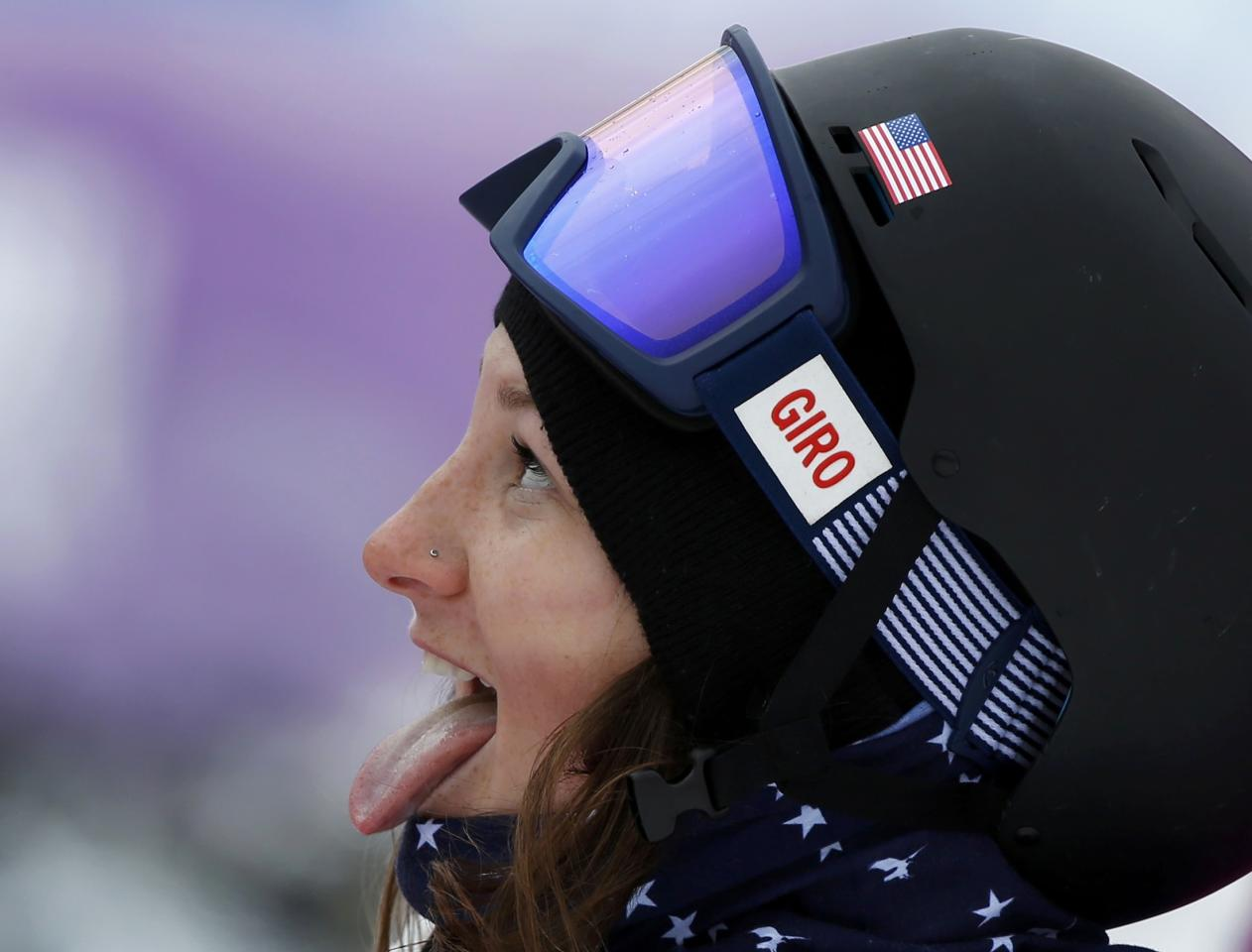 REFILE - CORRECTING DATE Devin Logan of the U.S. reacts in the finish area during the women's freestyle skiing slopestyle finals at the 2014 Sochi Winter Olympic Games in Rosa Khutor February 11, 2014. REUTERS/Mike Blake (RUSSIA - Tags: SPORT OLYMPICS SPORT SKIING)