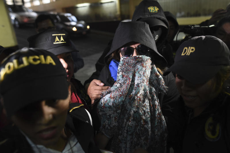 Former first lady and former presidential candidate Sandra Torres is escorted by police to court in Guatemala City, Monday, Sept. 2, 2019. Authorities arrested Torres at her home Monday on charges of campaign finance violations. (AP Photo/Oliver De Ros)