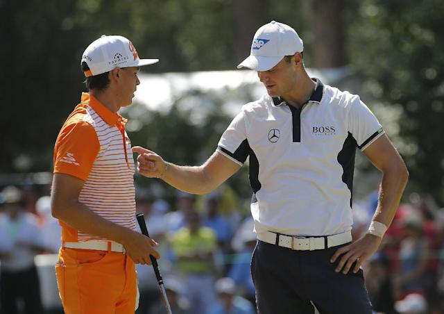 Martin Kaymer, of Germany, right, speaks with Rickie Fowler on the third hole during the final round of the U.S. Open golf tournament in Pinehurst, N.C., Sunday, June 15, 2014. (AP Photo/Matt York)