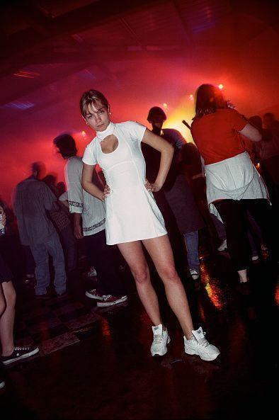 """<p>This is 1995 nightlife fashion at its finest: a white mock-neck tennis dress with cutouts paired with white sneakers. Cue """"This Is How We Do It"""" blasting through the speakers.</p>"""