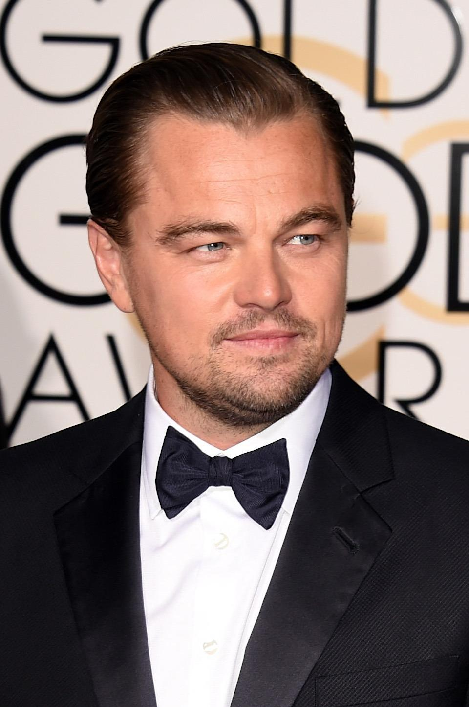 <p>The 40-year-old sported a bronzed hue, but it may be the work of the St. Barts sun. Leo was spotted sunbathing surrounded by beautiful women, unsurprisingly. <i>(Photo: Getty Images)</i></p>