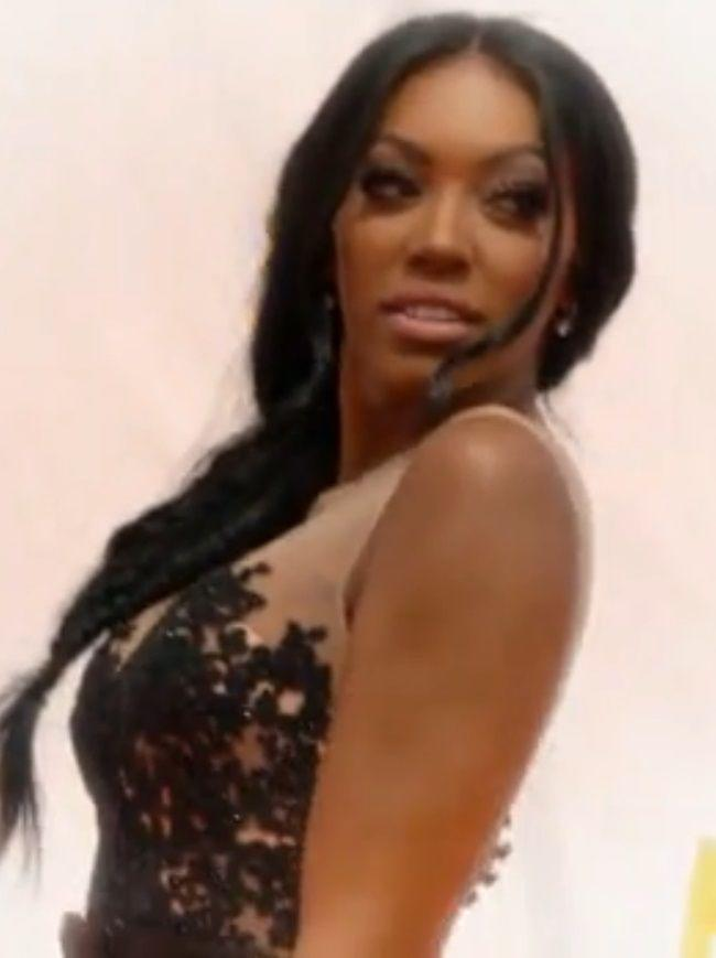Porsha Williams looks amazing in a shiny dress, with her hair styled to one side.