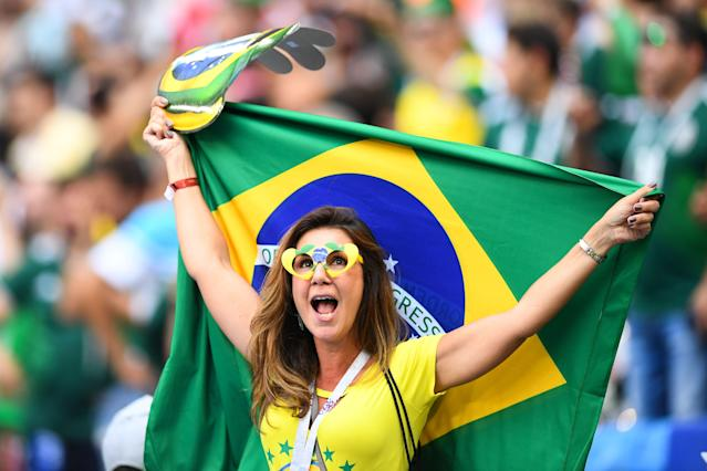 <p>A Brazil's fan cheers prior to the Russia 2018 World Cup round of 16 football match between Brazil and Mexico at the Samara Arena in Samara on July 2, 2018. (Photo by MANAN VATSYAYANA / AFP) </p>
