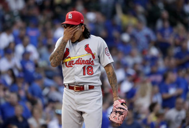 St. Louis Cardinals starting pitcher Carlos Martinez wipes his face after giving up a run during the third inning of a baseball game against the Chicago Cubs, Thursday, July 19, 2018, in Chicago. (AP Photo/Charles Rex Arbogast)