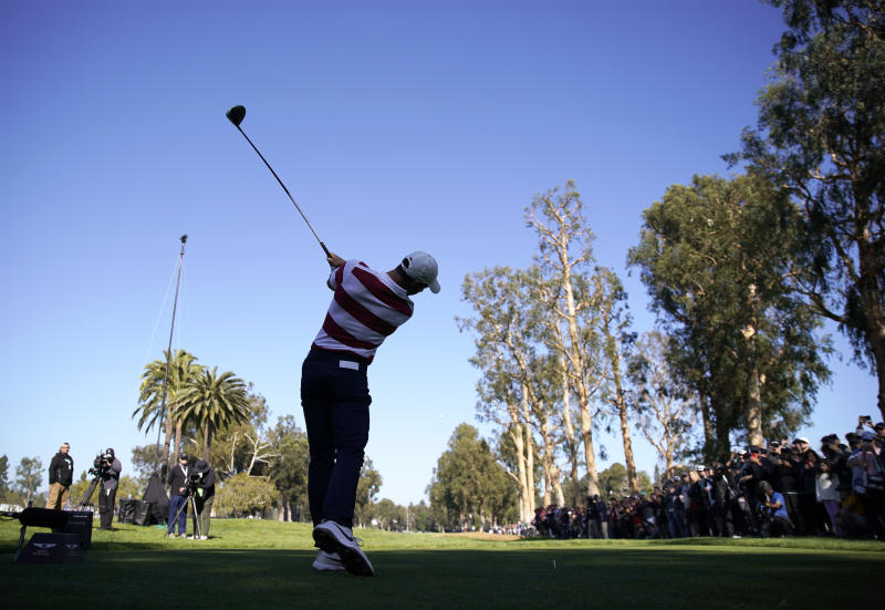 Rory McIlroy, of Northern Ireland, tees off on the 11th hole during the second round of the Genesis Invitational golf tournament at Riviera Country Club, Friday, Feb. 14, 2020, in the Pacific Palisades area of Los Angeles. (AP Photo/Ryan Kang)