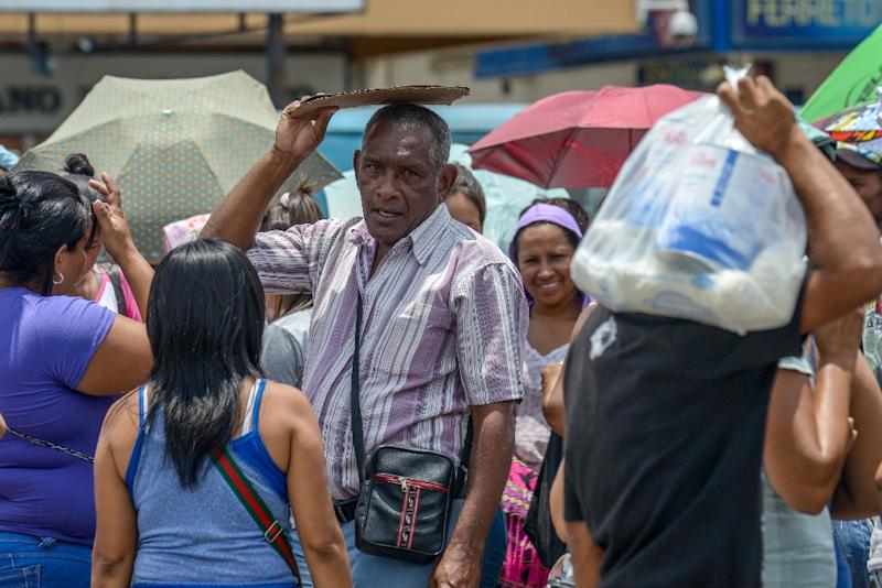 Venezuelans go from supermarket to supermarket, and store to store, clamoring for basic necessities which have pricesregulated by the leftist government (AFP Photo/Federico Parra)