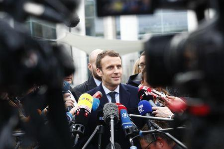 Macron, head of the political movement En Marche ! leaves the Chancellery after meeting German Chancellor Merkel in Berlin