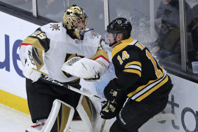 Boston Bruins right wing Chris Wagner (14) tangles with Vegas Golden Knights goaltender Marc-Andre Fleury (29) during the first period of an NHL hockey game in Boston, Tuesday, Jan. 21, 2020. (AP Photo/Charles Krupa)