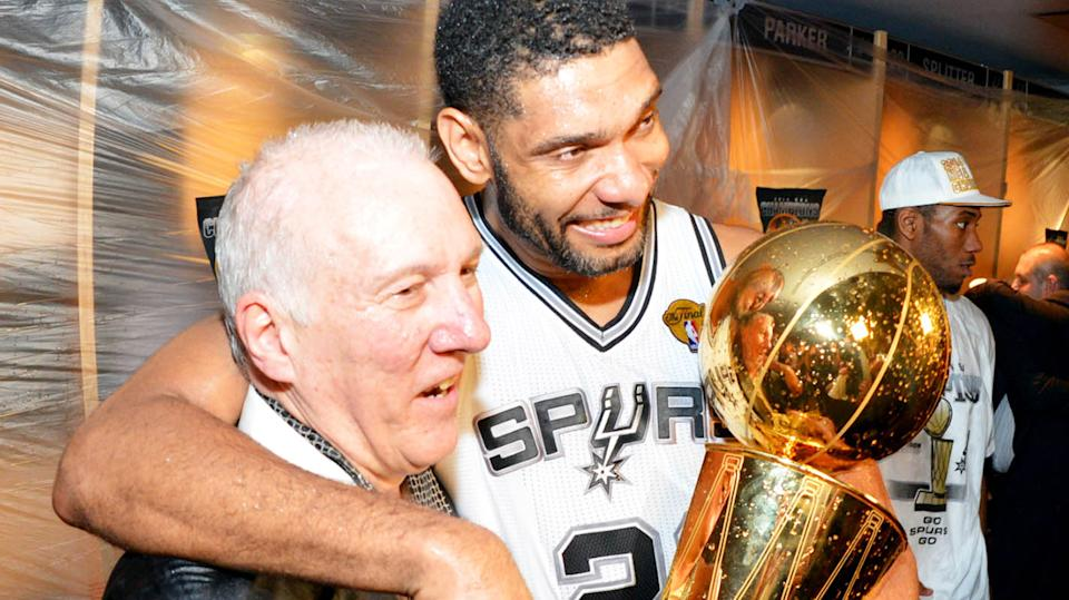San Antonio Spurs coach is pictured with Tim Duncan after winning the 2014 NBA Finals.