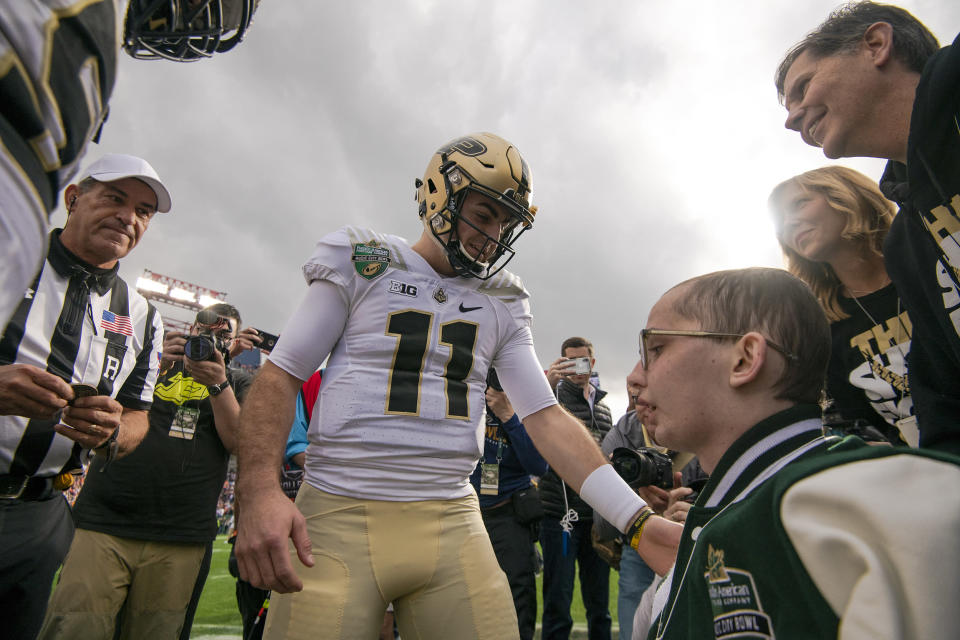 Purdue fan Tyler Trent (R) was a captain at the Music City Bowl. (Photo by Timothy Nwachukwu/Getty Images)