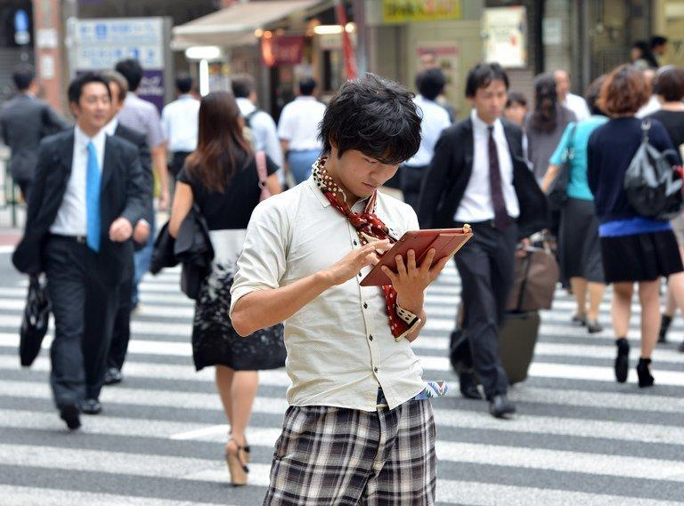 University student Akihiro Matsumura uses his tablet computer in Tokyo on June 19, 2013. Computers and smartphones have relieved youngsters like Matsumura of the need to remember how to write the thousands of Chinese characters or kanji in use across East Asia
