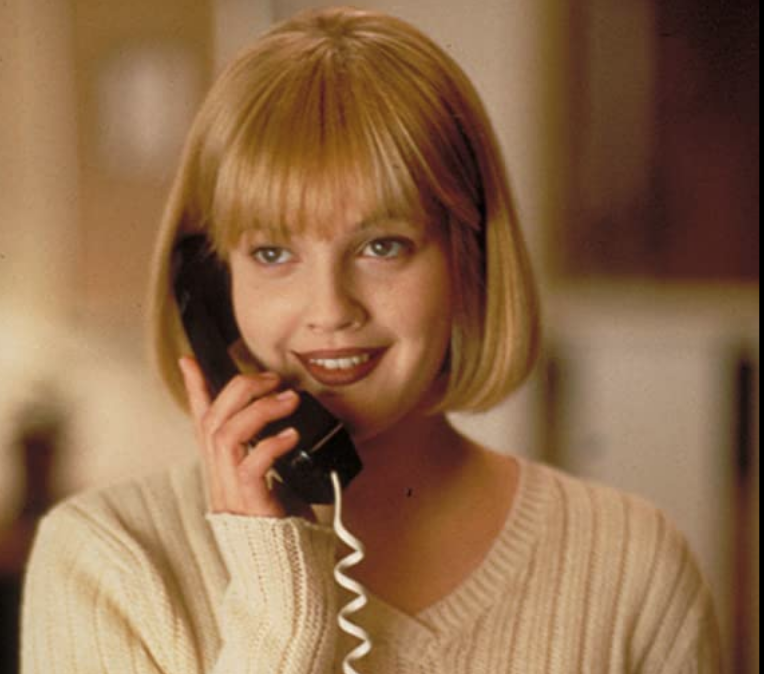 <p>Drew Barrymore's hairstyle from <em>Scream</em> is one of the most recognizable beauty looks in cinematic history. Period. Her brown lipstick isn't far from the top of that list either.</p>
