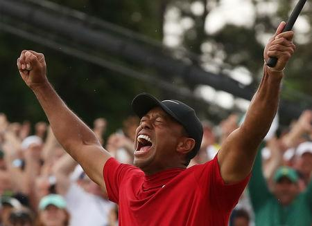 Golf - Masters - Augusta National Golf Club - Augusta, Georgia, U.S. - April 14, 2019. Tiger Woods of the U.S. celebrates on the 18th hole to win the 2019 Masters. REUTERS/Jonathan Ernst