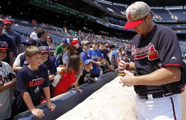 Atlanta Braves pitcher Gavin Floyd signs autographs before a baseball game against the Boston Red Sox on Monday, May 26, 2014, in Atlanta, Ga. (AP Photo/Butch Dill)
