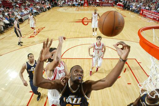 HOUSTON, TX - APRIL 11: Al Jefferson #25 of the Utah Jazz rebounds the ball against the Houston Rockets on April 11, 2012 at the Toyota Center in Houston, Texas. (Photo by Bill Baptist/NBAE via Getty Images)