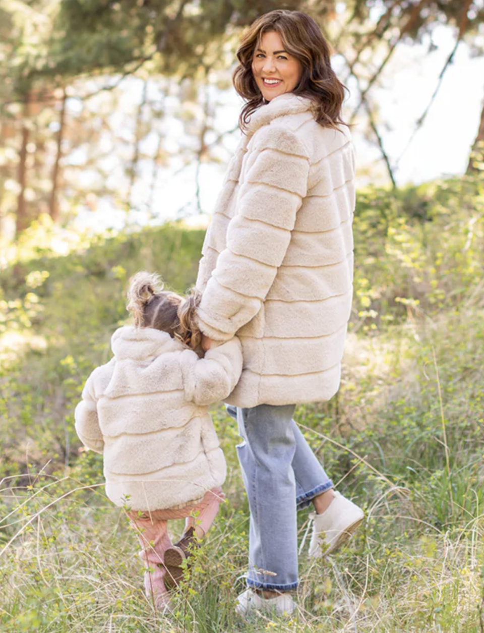 Jillian Harris and her daughter Annie wearing matching Harris Coats outside in grass