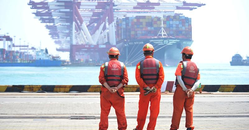 Workers stand at the port of Qingdao, Shandong province, China June 10, 2019.