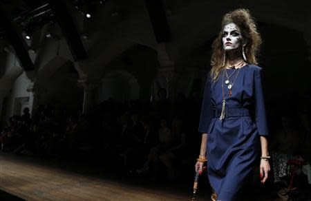 A model presents a creation from the Vivienne Westwood Red Label Spring/Summer 2014 collection during London Fashion Week September 15, 2013. REUTERS/Suzanne Plunkett