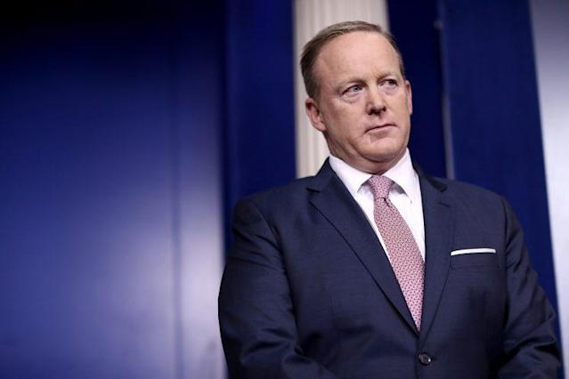 White House press secretary Sean Spicer listens to national security adviser H.R. McMaster during the daily news conference at the White House on Friday. (Photo: Win McNamee/Getty Images)