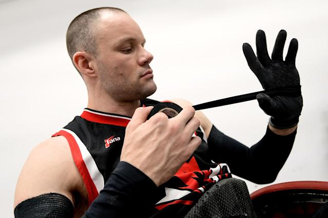 RIO DE JANEIRO, BRAZIL - FEBRUARY 26: Micheal Whitehead of Canada prepares before the match between Canada and Australia during the International Wheelchair Rugby Championship - Aquece Rio Test Event for the Rio 2016 Paralympics at Olympic Park on February 26, 2016 in Rio de Janeiro, Brazil. (Photo by Buda Mendes/Getty Images)