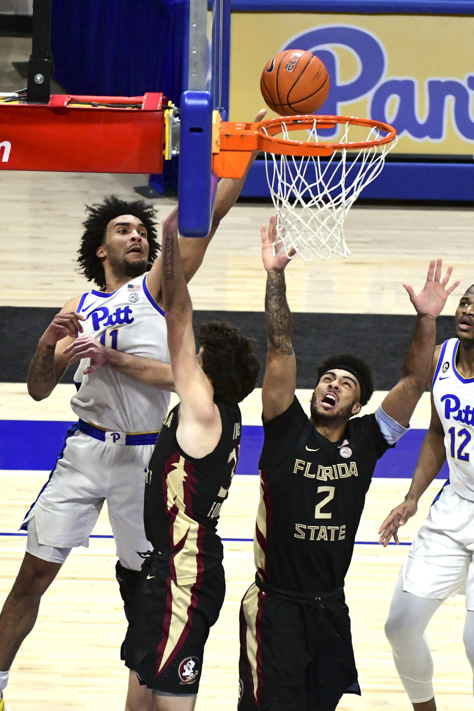 Pittsburgh forward Justin Champagnie, left, shoots against Florida State during the first half of an NCAA college basketball game, Saturday, Feb. 20, 2021, in Pittsburgh. (AP Photo/Fred Vuich)
