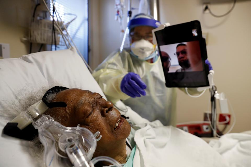 Florence Bolton, 85, a coronavirus disease (COVID-19) positive patient, lies in her intensive care bed as family members attempt to FaceTime her at Roseland Community Hospital  on the South Side of Chicago, Illinois, U.S., December 1, 2020. REUTERS/Shannon Stapleton     TPX IMAGES OF THE DAY