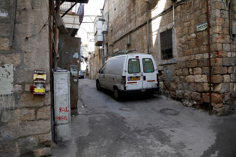 A street corner in Jerusalem's Mea Shearim neighbourhood where Ultra-Orthodox Jewish men sort their cooking utensils at they dip them in boiling water to remove remains of leaven in preparation for the Jewish holiday of Passover, seen deserted amid the cor