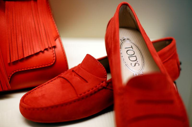 FILE PHOTO: A pair of shoes of the Italian luxury shoemaker Tod's are displayed in Sant'Elpidio a Mare