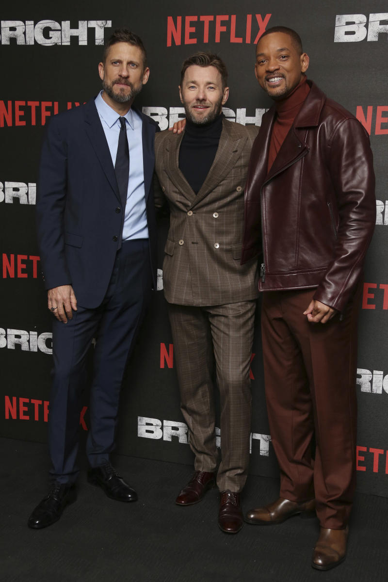Will Smith, right Joel Edgerton, and Director David Ayer, left pose for photographers upon arrival at the European premiere of the Netflix film 'Bright' in London, Friday, Dec. 15th, 2017. (Photo by Joel C Ryan/Invision/AP)