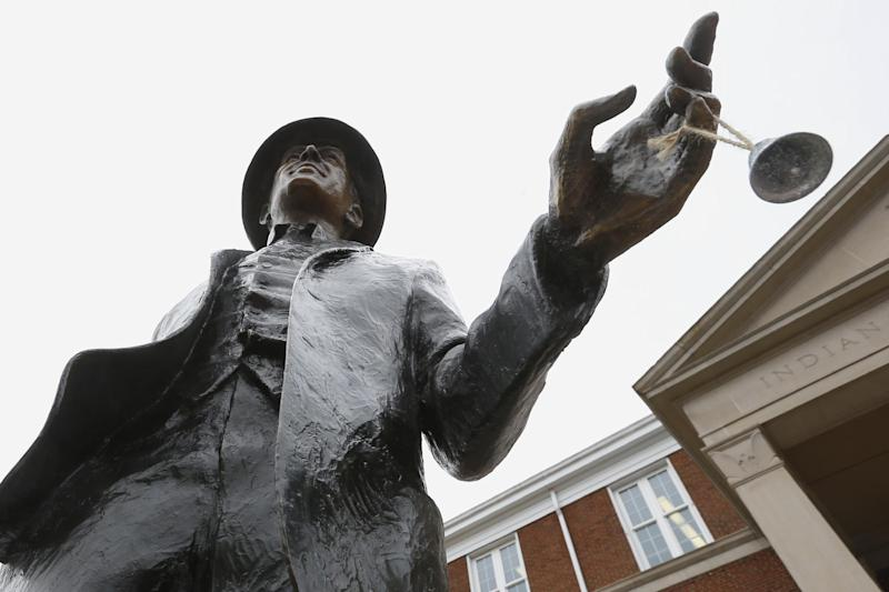"""In this photo made on Friday, Dec. 20, 2013, a silver bell hangs from the finger of the statue of Jimmy Stewart outside the county courthouse in Indiana, Pa. A museum dedicated to the star of the holiday film favorite """"It's A Wonderful Life"""" is located in the off-the-beaten track town where Stewart grew up. The museum still attracts visitors from all over the country. It's full of displays not just about Hollywood, but about Stewart's service as a bomber pilot in World War II, his well-to-do ancestors, and his family life. (AP Photo/Keith Srakocic)"""