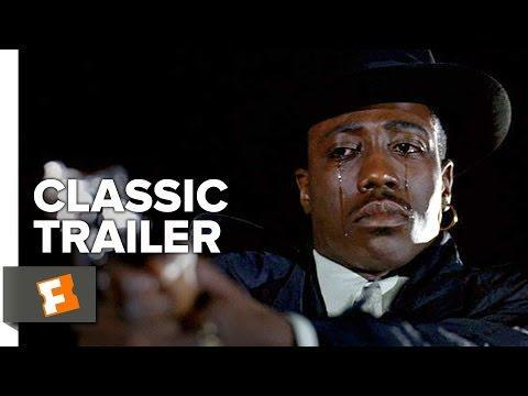 "<p>The 1991 film sees Wesley Snipes play Nino Brown, a powerful drug lord in New York City who gets rich during the crack epidemic, while Ice-T plays Scotty Appleton, a detective who goes undercover in Nino's gang in order to stop him. </p><p><a class=""link rapid-noclick-resp"" href=""https://www.amazon.com/New-Jack-City-Wesley-Snipes/dp/B001QDB7KC/?tag=syn-yahoo-20&ascsubtag=%5Bartid%7C2139.g.33380025%5Bsrc%7Cyahoo-us"" rel=""nofollow noopener"" target=""_blank"" data-ylk=""slk:Stream it here"">Stream it here</a></p><p><a href=""https://www.youtube.com/watch?v=pumf6m7d14w"" rel=""nofollow noopener"" target=""_blank"" data-ylk=""slk:See the original post on Youtube"" class=""link rapid-noclick-resp"">See the original post on Youtube</a></p>"