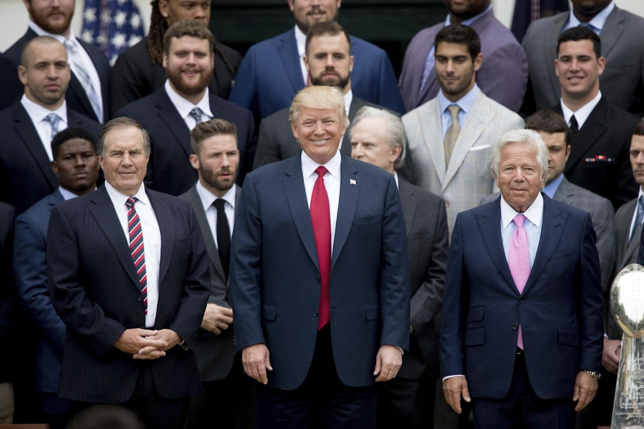 <p>President Donald Trump, flanked by New England Patriots head coach Bill Belichick, left, and owner Robert Kraft, poses with members of the New England Patriots during a ceremony on the South Lawn of the White House in Washington, Wednesday, April 19, 2017, where the president honored the Super Bowl Champion New England Patriots for their Super Bowl LI victory. (AP Photo/Andrew Harnik) </p>