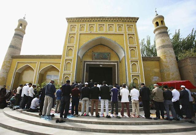 <b>KASHI, CHINA: </b>Muslims pray outside a mosque in Kashi of Xinjiang Uygur Autonomous Region, northwest China. Kashi is an oasis city which has been noted in ancient times along the old silk road as a political and commercial centre. It is the hub of an important commercial district, bordering Russia, Afghanistan, Kazakhstan, Tajikistan, Kyrgyzstan and Uzbekistan with Pakistan to its south. The Islamic Uygur ethnic minority group constitutes the majority of its population.