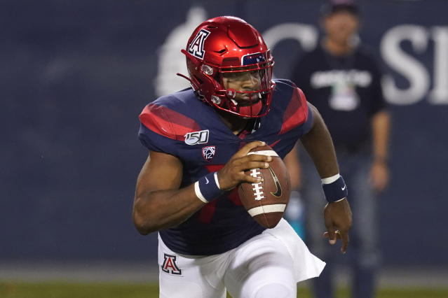 Arizona quarterback Khalil Tate looks down field against Northern Arizona in the second half during an NCAA college football game, Saturday, Sept. 7, 2019, in Tucson, Ariz. (AP Photo/Rick Scuteri)