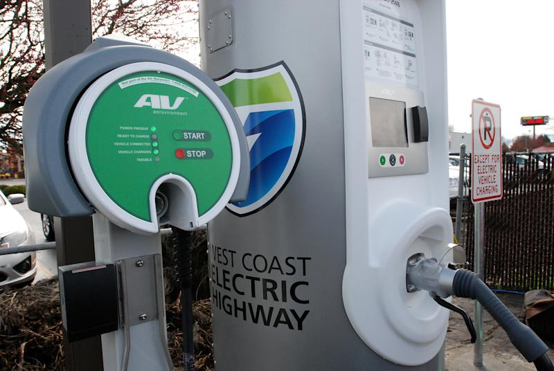 An electric car fast-charging statioin stands ready Friday, March 16, 2011 off Interstate 5 in Central Point, Ore. The Oregon Department of Transportation opened the first 160-mile section of an Electric Highway that will ultimately allow electric cars to travel from Canada to Mexico along the nation's second-busiest interstate.
