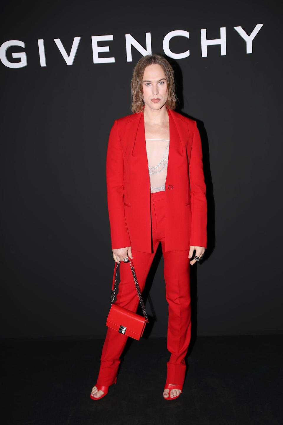 <p>She wore the be-all and end-all of red power suits with red sandals and a matching purse.</p>