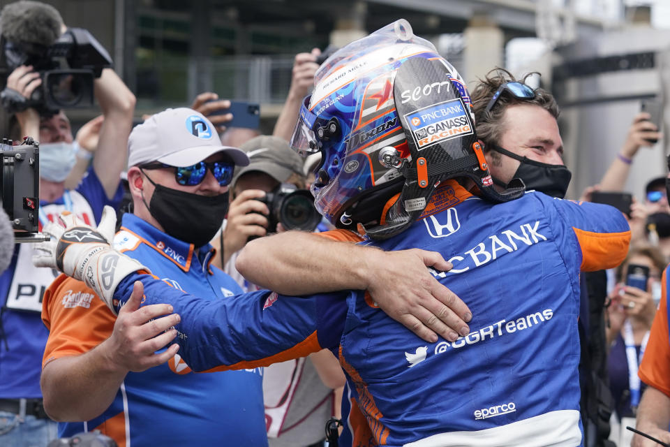Scott Dixon, of New Zealand, greets his pit crew after Dixon won the pole for the Indianapolis 500 auto race at Indianapolis Motor Speedway, Sunday, May 23, 2021, in Indianapolis. (AP Photo/Darron Cummings)