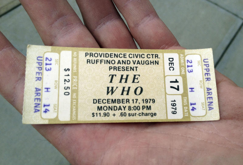 CORRECTS ID - Emery Lucier, 50, of Milford, Mass. holds a ticket for a canceled 1979 concert by The Who at the Dunkin Donuts Center in Providence, R.I., Tuesday, July 31, 2012. Lucier was among fans who redeemed tickets from a canceled 1979 show, for The Who's Quadrophenia show set to play there in February 2013. Their 1979 concert was canceled due to safety concerns after 11 people died in a stampede before a show in Ohio. (AP Photo/Michelle R. Smith)