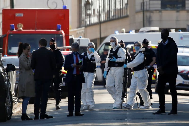 Police secure the area where an attacker stabbed a woman, in Rambouillet