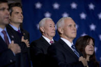 """FILE - In this Dec. 20, 2019, file photo from left, Defense Secretary Mark Esper, Rep. Matt Gaetz, R-Fla., Rep. Greg Pence, R-Ind., Vice President Mike Pence, and Karen Pence, stand on stage during the playing of the National Anthem before President Donald Trump signs the National Defense Authorization Act for Fiscal Year 2020 at Andrews Air Force Base, Md. In one of the most chilling scenes from the Jan. 6 insurrection, a violent mob surged through the halls of the U.S. Capitol chanting """"hang Mike Pence."""" But when the House moved this week to create an independent commission to investigate the tragedy, the former vice president's brother voted no. (AP Photo/Andrew Harnik, File)"""