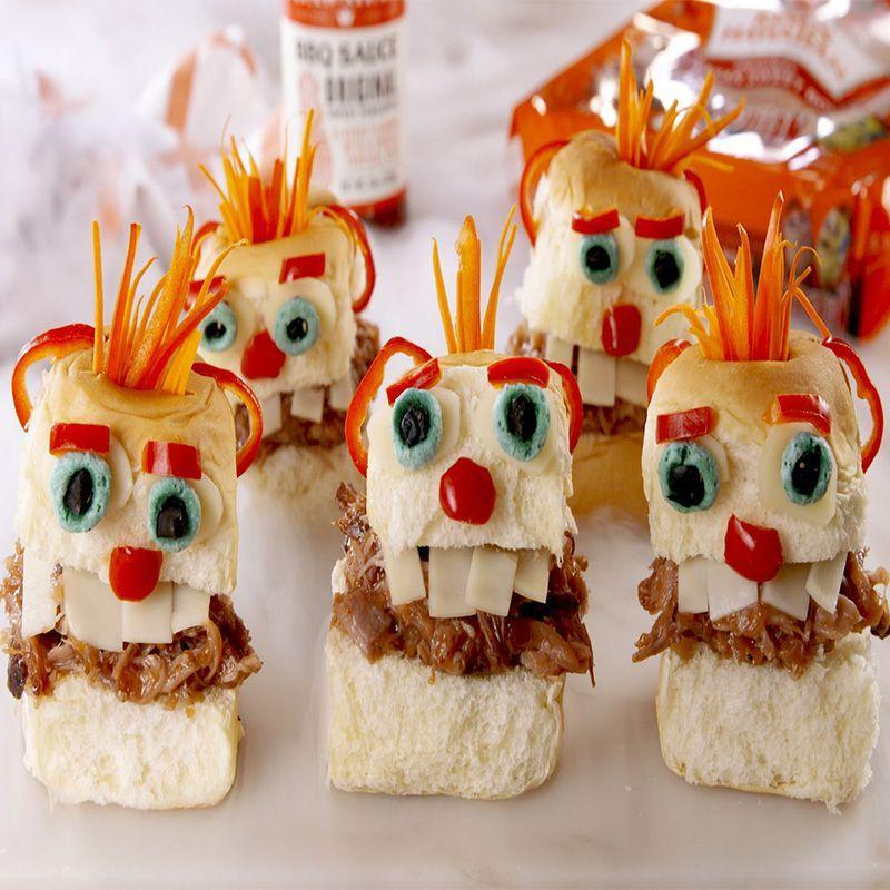 """<p>Your guests will happily munch on these monsters that look like they're coming to munch on you.</p><p><em>Get the recipe at <a href=""""https://www.delish.com/cooking/recipe-ideas/a22827160/pulled-pork-menehune-sliders-recipe/"""" rel=""""nofollow noopener"""" target=""""_blank"""" data-ylk=""""slk:Delish"""" class=""""link rapid-noclick-resp"""">Delish</a>. </em></p>"""
