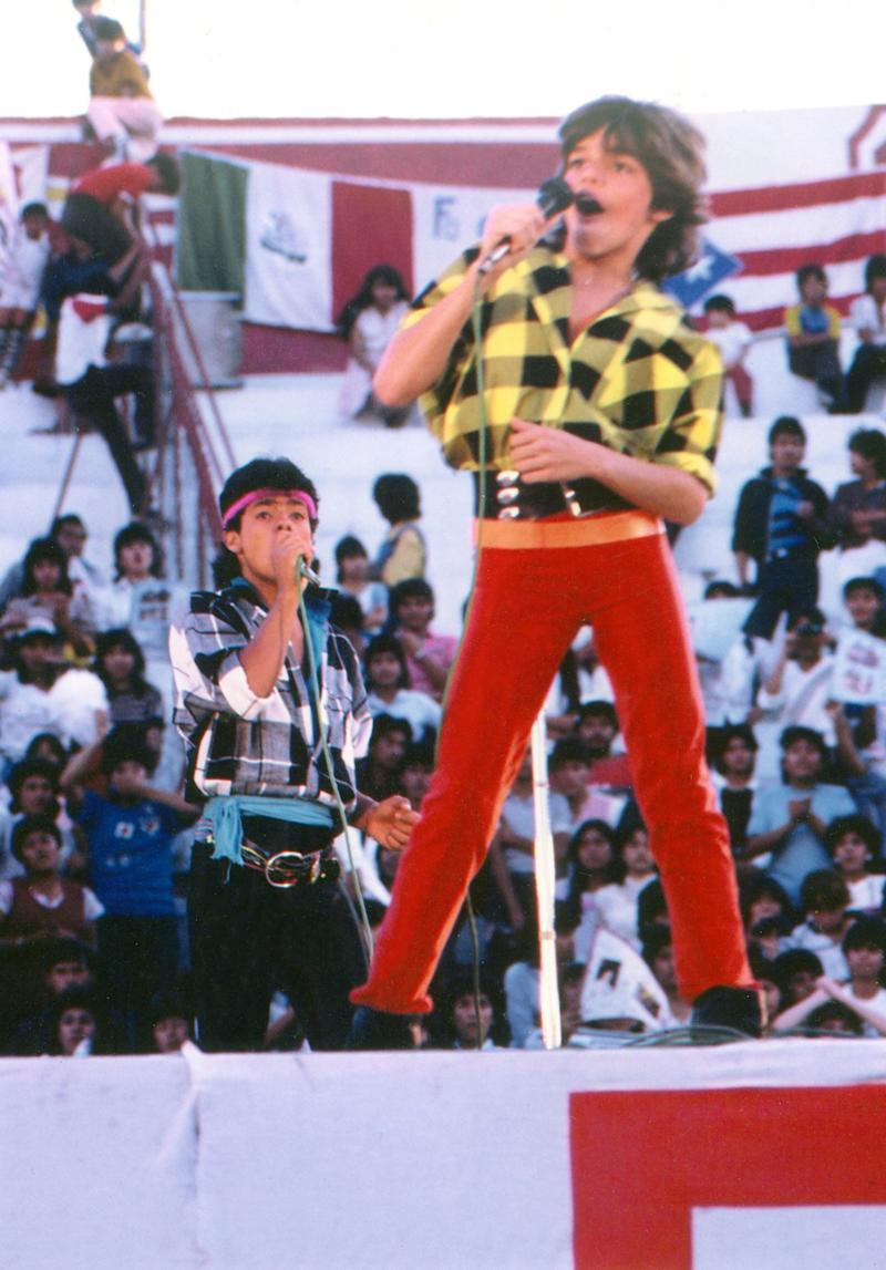 Singing with Menudo in 1984.
