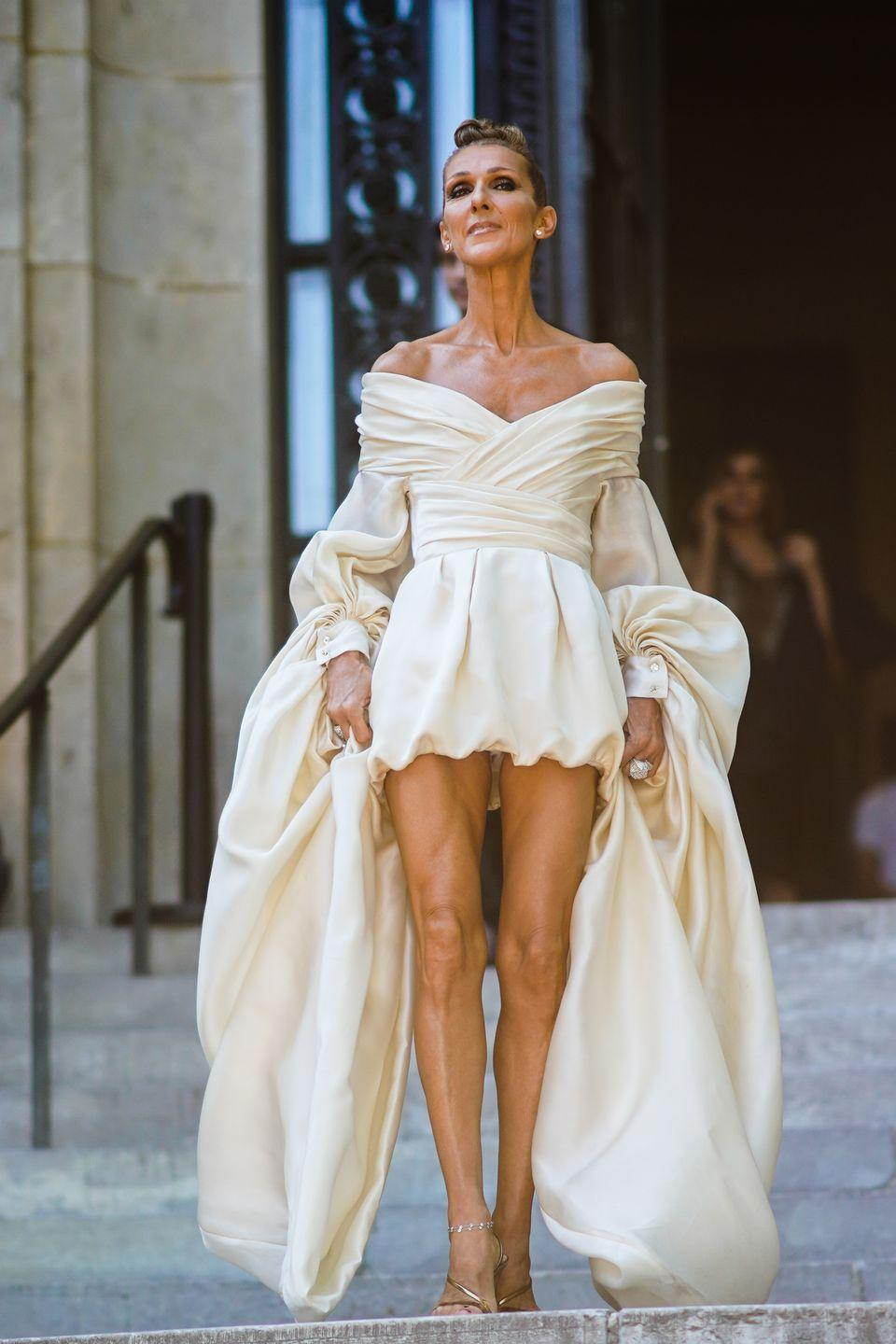 <p>Dion looked simply angelic in an ivory draped minidress during Paris Fashion Week. Her accessories were small yet mighty and her gold strappy heels added the perfect finishing touch. </p>