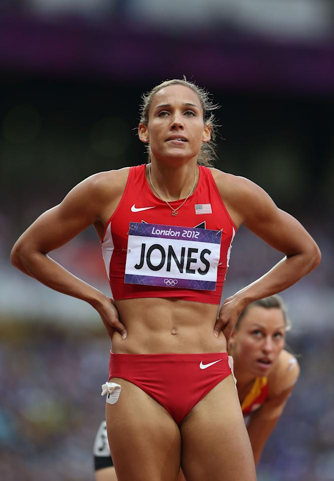 LONDON, ENGLAND - AUGUST 07:  Lolo Jones of the United States looks on after competing in the Women's 100m Hurdles Semifinals on Day 11 of the London 2012 Olympic Games at Olympic Stadium on August 7, 2012 in London, England.  (Photo by Streeter Lecka/Getty Images)