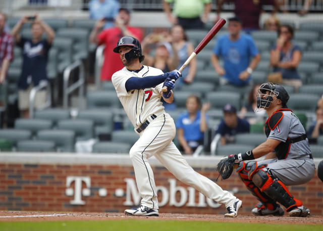 Atlanta Braves' Dansby Swanson hits a two-run single in the ninth inning of a baseball game against the Miami Marlins, Sunday, May 20, 2018, in Atlanta. (AP Photo/Todd Kirkland)