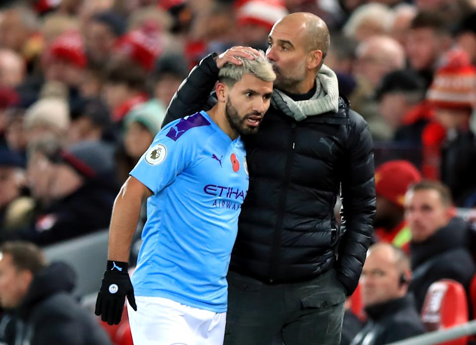 Pep Guardiola (right), Sergio Aguero and Manchester City have their eyes on chasing down Liverpool again. (Photo by Peter Byrne/PA Images via Getty Images)