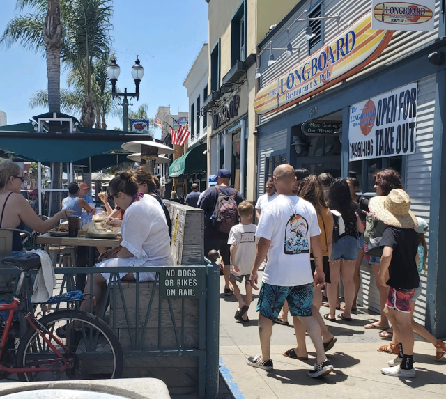 Ten miles south, in Huntington Beach, the streets and restaurants were full. (Yahoo)
